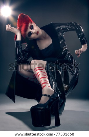 Fashion shot of a girl with bright red hair - stock photo