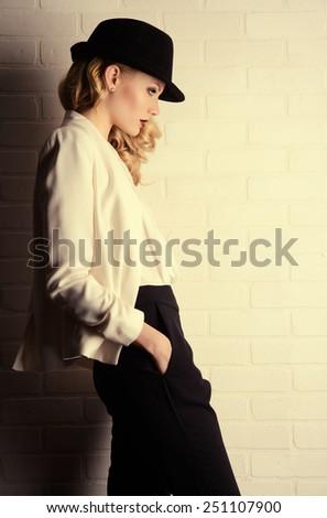 Fashion shot of a glamorous blonde woman. - stock photo