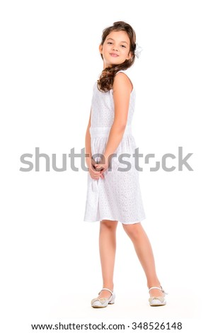 Fashion shot of a pretty eight-year girl wearing white dress. Studio shot. Kid's beauty, fashion. Isolated over white.  - stock photo