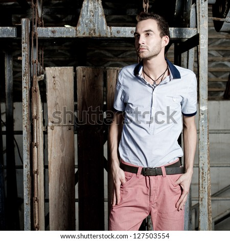 fashion shot of a young elegant man a professional model - stock photo