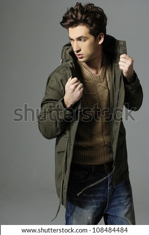 Fashion Shot of a young man in coat. He is now a professional model. - stock photo