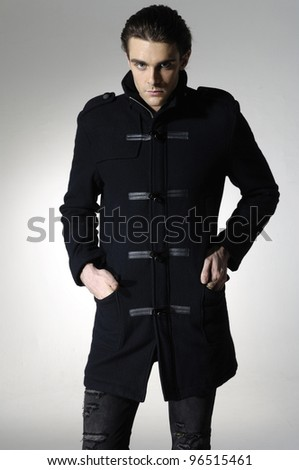 Fashion Shot of a young man in coat- professional model.