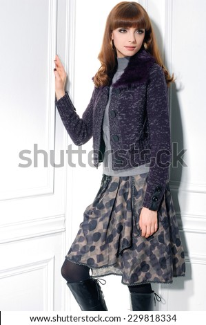 fashion shot of girl posing in studio - stock photo