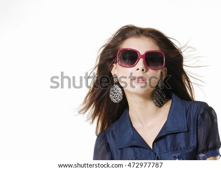 fashion shot of girl with coat in sunglasses