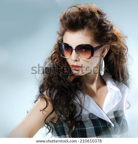 fashion shot of girl with sunglasses  - stock photo