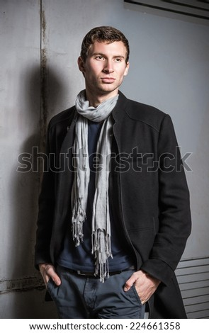 Fashion shot: portrait of handsome young man wearing jeans and coat - stock photo