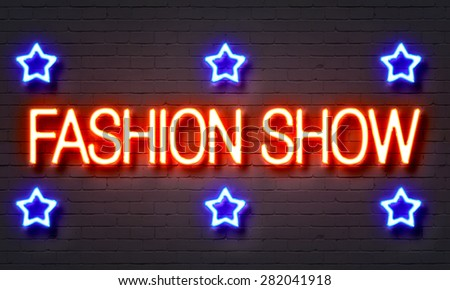 Fashion show neon sign on brick wall background - stock photo