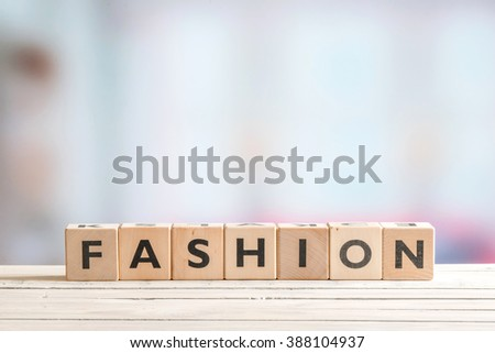 Fashion sign made of wooden blocks on a table