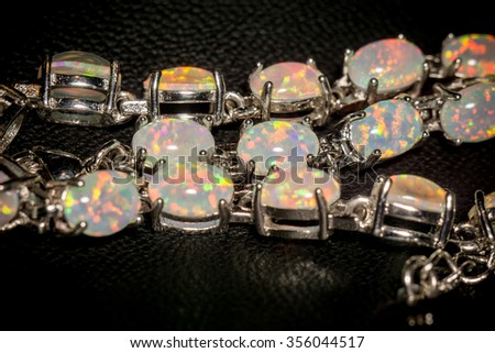 Fashion silver bracelet with white fire opals.