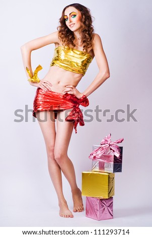 fashion smiling woman model with beauty bright make-up posing in studio. Beautiful famale face with clean skin. - stock photo