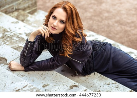fashion street photo session of stylish young lady in a black clothes