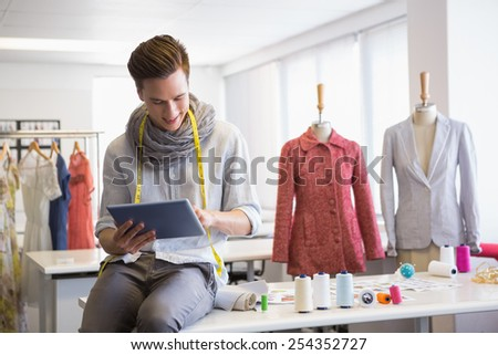 Fashion student working on tablet computer at the college