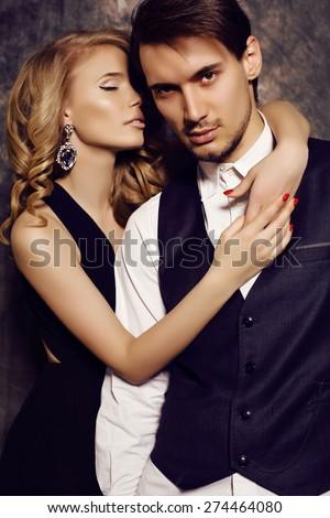 fashion studio photo of beautiful sensual couple in elegant clothes  - stock photo