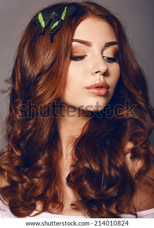 fashion studio photo of beautiful young girl with beige makeup and dark curly hair