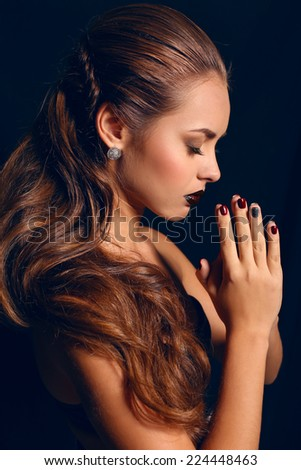 fashion studio photo of beautiful young woman with dark hair and bright makeup