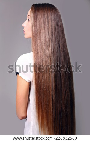 fashion studio photo of beautiful young woman with luxurious long hair, natural color - stock photo