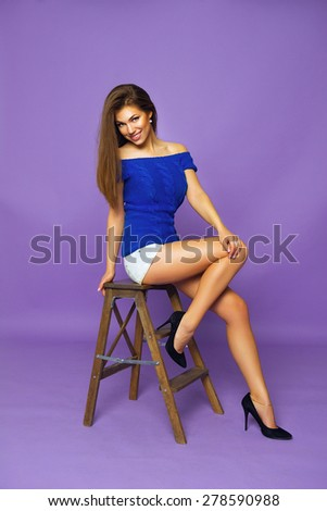 Fashion Studio Photo of Glamor Stylish Beautiful Young Woman Model in Summer Bright Colorful Cloth. Fashionable Look, Tan, Long Healthy Hair - stock photo