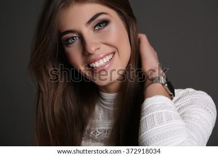 fashion studio photo of gorgeous sensual woman with dark straight hair and natural makeup,wears elegant dress  - stock photo