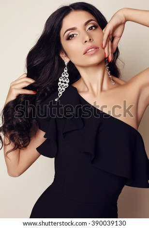 fashion studio photo of gorgeous woman with dark hair and evening makeup, wears elegant dress and bijou