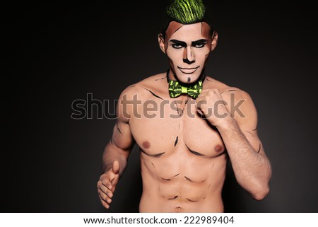 fashion studio photo of sexy man with painted face and body for Halloween party