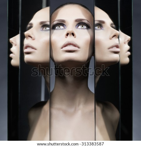 Fashion studio portrait of woman and mirrors on black background