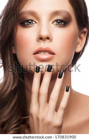 Fashion studio portrait of young beautiful woman with bright makeup and black manicure, isolated on white