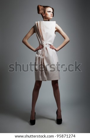 Fashion style - elegant lady with beautiful hairstyle isolated on grey background