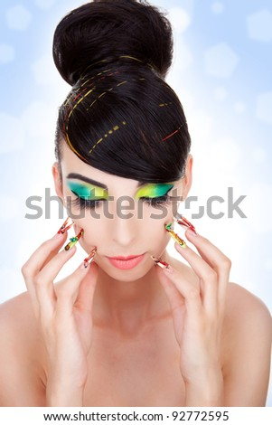 Fashion style, manicure, cosmetics and make-up.  Shiny slicked back hairstyle. Beautiful woman pushing her nails against her face - stock photo