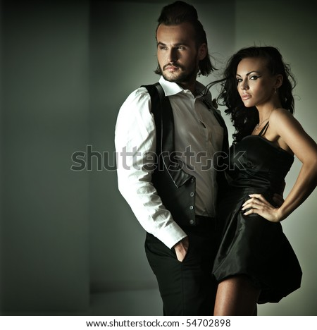 Fashion style photo of a cute couple - stock photo