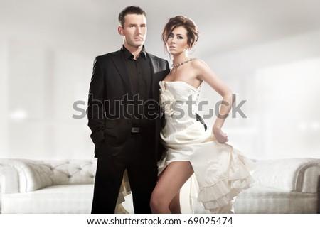 Fashion style photo of a cute couple - stock photo