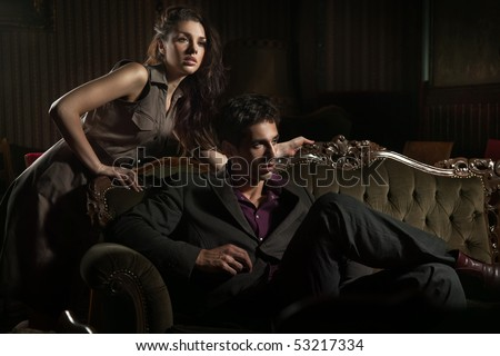 Fashion style photo of an attractive pair posing - stock photo