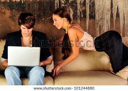 Fashion style photo of an attractive young couple at their grunge apartment at evening