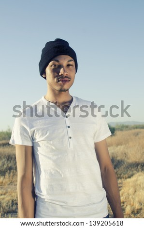 Fashion style portrait of young African - stock photo