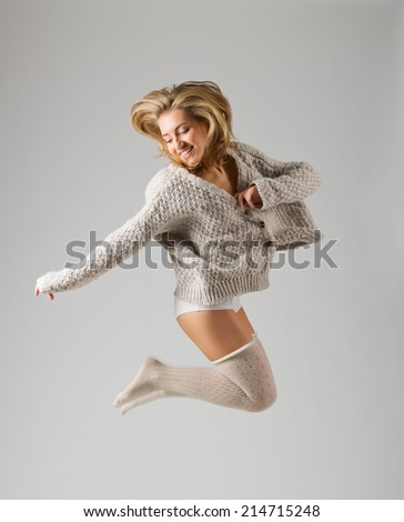 Fashion style portrait of young girl on grey background