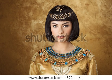Fashion Stylish Beauty Portrait with Black Short Haircut and Professional Make-Up of Cleopatra. Beautiful Girl's Face Close-up. - stock photo
