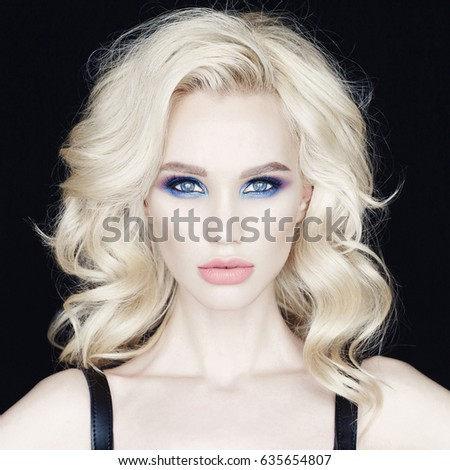 Fashion stylish photo of beautiful blonde young woman with bright makeup. Perfect makeup