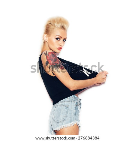 Fashion swag sexy blonde young woman posing and looking at camera.  White background, not isolated - stock photo