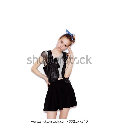 Fashion swag young woman gun showing. Girl having fun. White background, not isolated - stock photo
