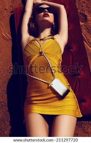 Fashion tanned woman - stock photo