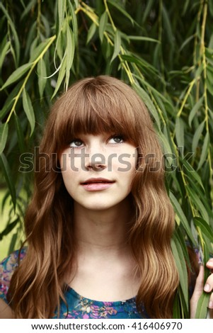 fashion teen girl with bands standing in leaves