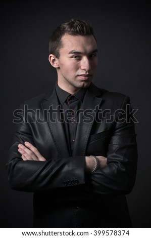 Fashion trendy elegant young man in black suit