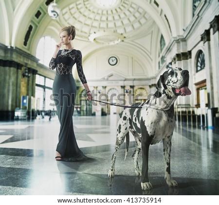 Fashion type photo of a stylish woman with a dog - stock photo