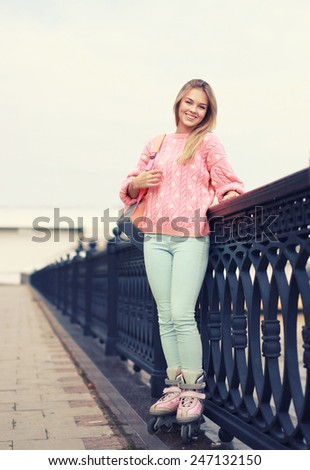 Fashion, vacation and people concept - pretty stylish smiling roller girl outdoors - stock photo