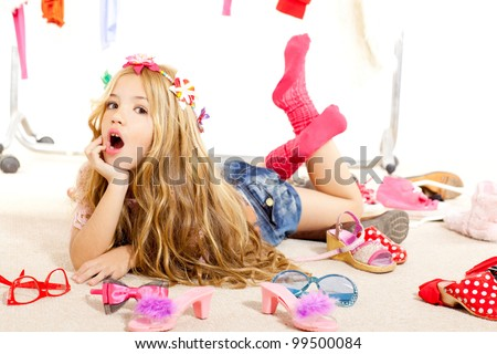 fashion victim kid girl wardrobe messy like backstage model - stock photo