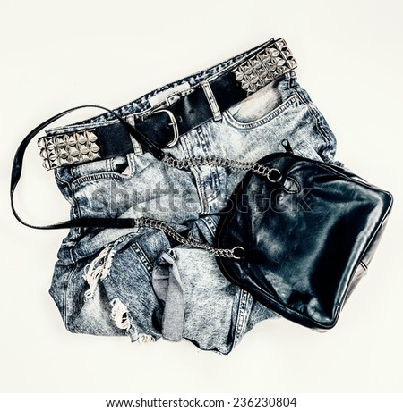 Fashion vintage jeans with black leather bag. metal style - stock photo