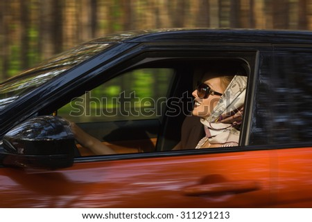 Fashion vintage woman behind steering wheel
