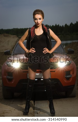 Fashion vintage woman standing near vehicle - stock photo