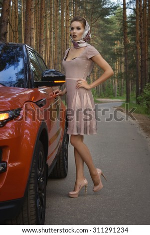 Fashion vintage woman with car - stock photo