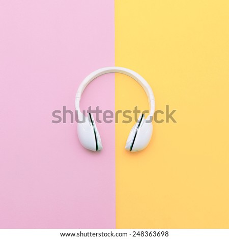 Fashion white headphones on Vanilla background. Urban Summer time - stock photo