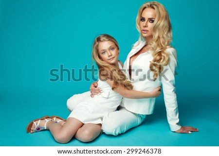 Fashion woman and pretty little girl - stock photo